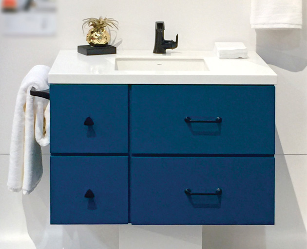 These days, cabinetry can be purchased in almost any color. This midnight blue floating vanity is right on trend. Photo by Linda Holt.