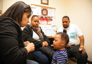 Dakota, K'loni and Louis visit with Betsy Green, Family Services' parent education facilitator. Photo by Meghan Moore.