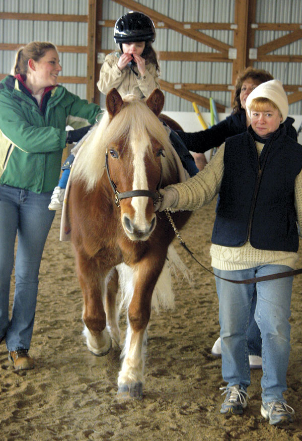 Laurel Salladay of Hampstead goes through her classes at the Carriage Barn Equestrian Center.