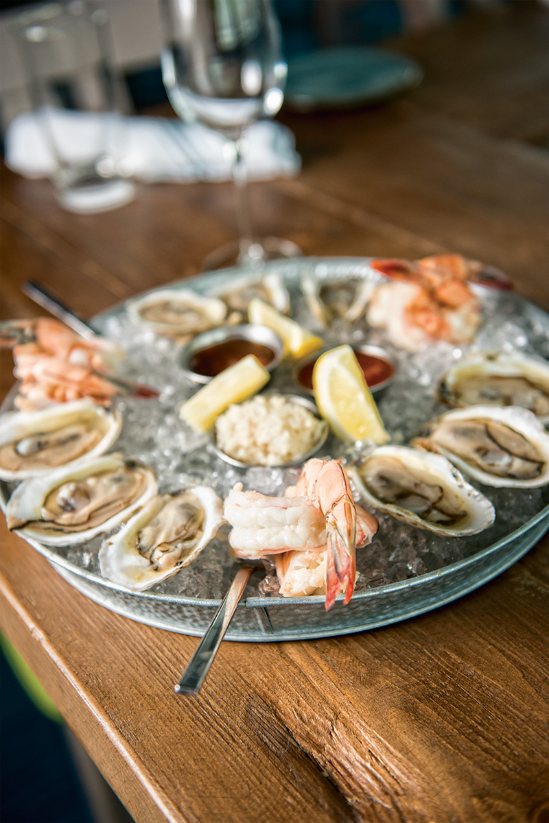 a raw seafood bar with a daily oyster assortment is one of the many reasons to visit the great road kitchen photo by kevin harkins - Great Road Kitchen