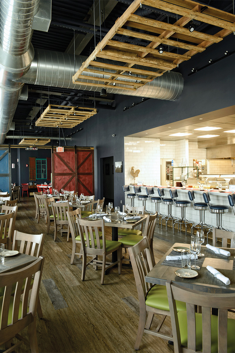 the great road kitchen features a big and open dining area photo by kevin harkins - Great Road Kitchen