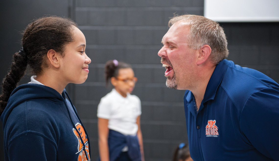 Lemay, a seasoned actor and gifted educator, tries to goad a student into losing focus during a theatrical game. Photo by Kevin Harkins.