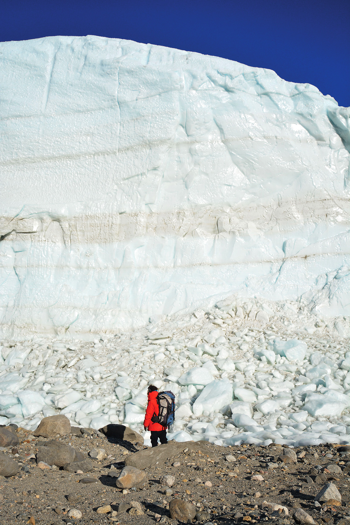 Winsor stands in front of Taylor Glacier. Photo courtesy UMass Lowell.